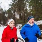 Senior Couple jogging in the snow