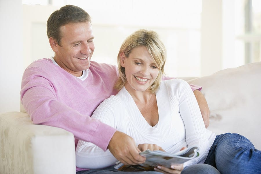 Couple Relaxing with a Magazine