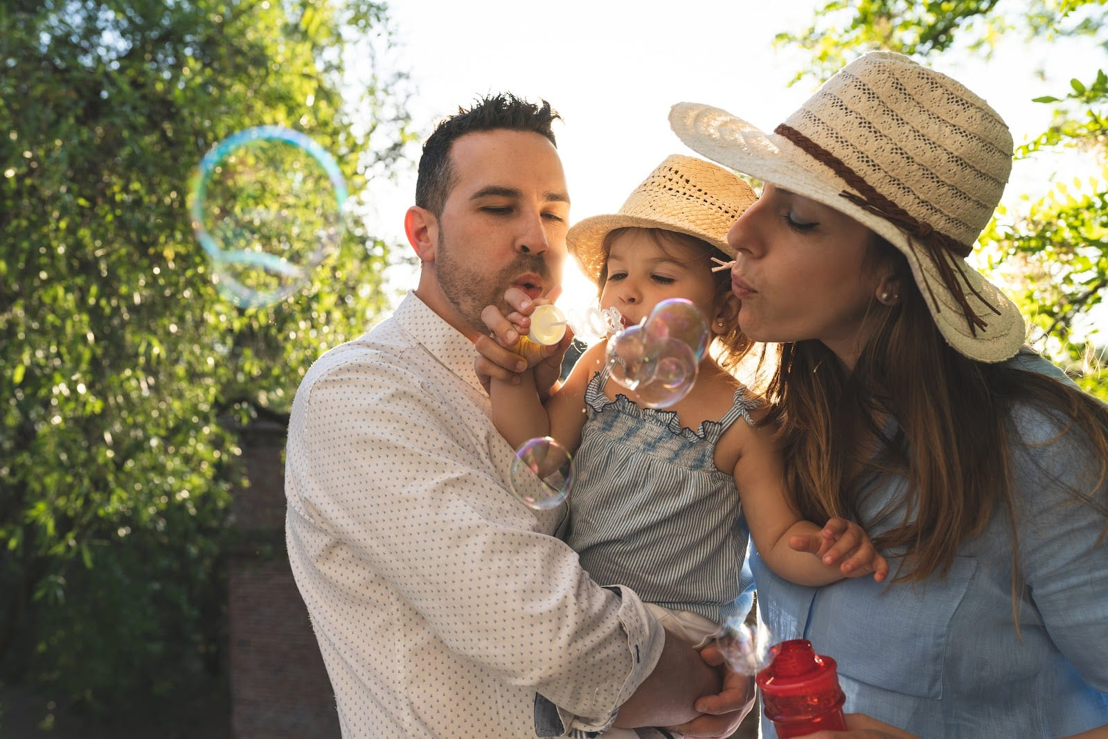 happy family blowing bubbles
