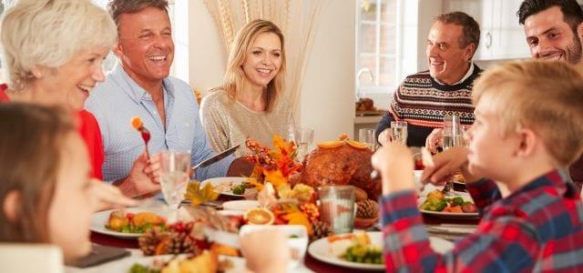 extended family eating thanksgiving dinner