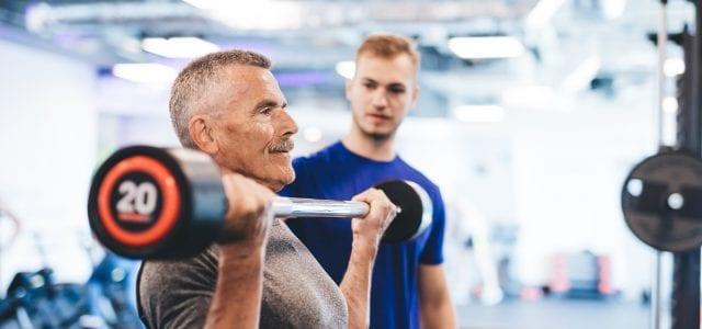older man lifting weights