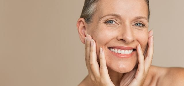 A woman smiles and feels fresh following proper skincare treatments.